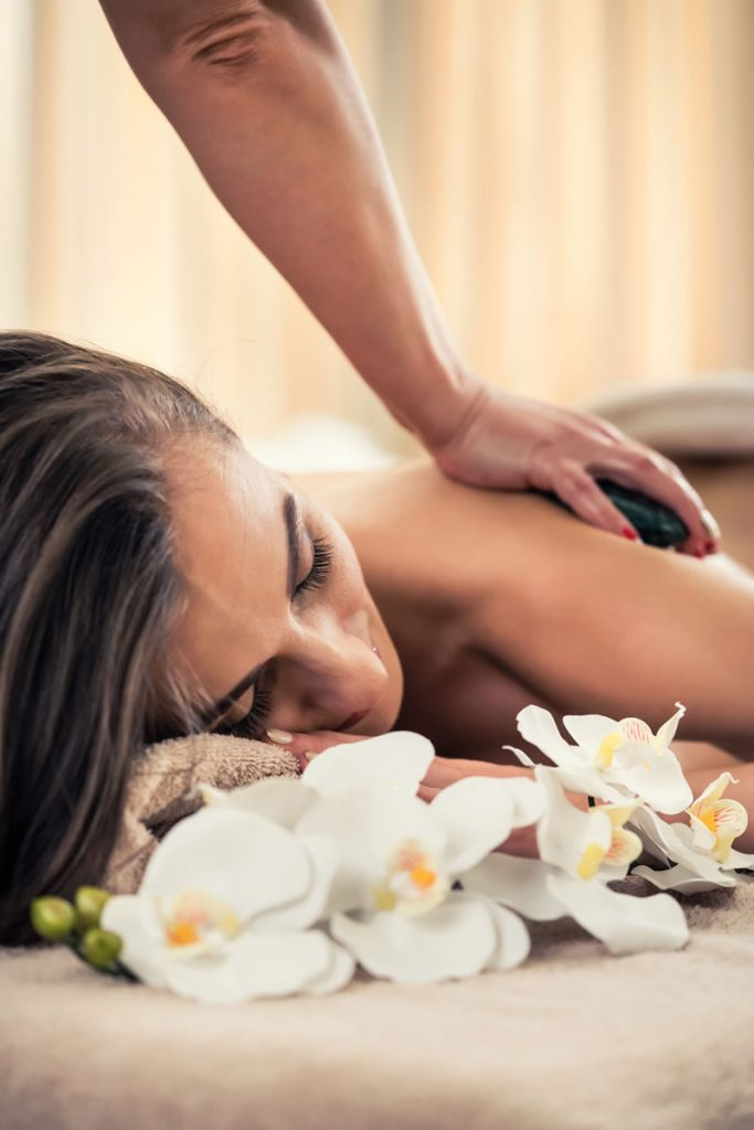 Therapeutic Massage - Woman having hot stone therapy