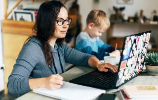 Woman at home working with son